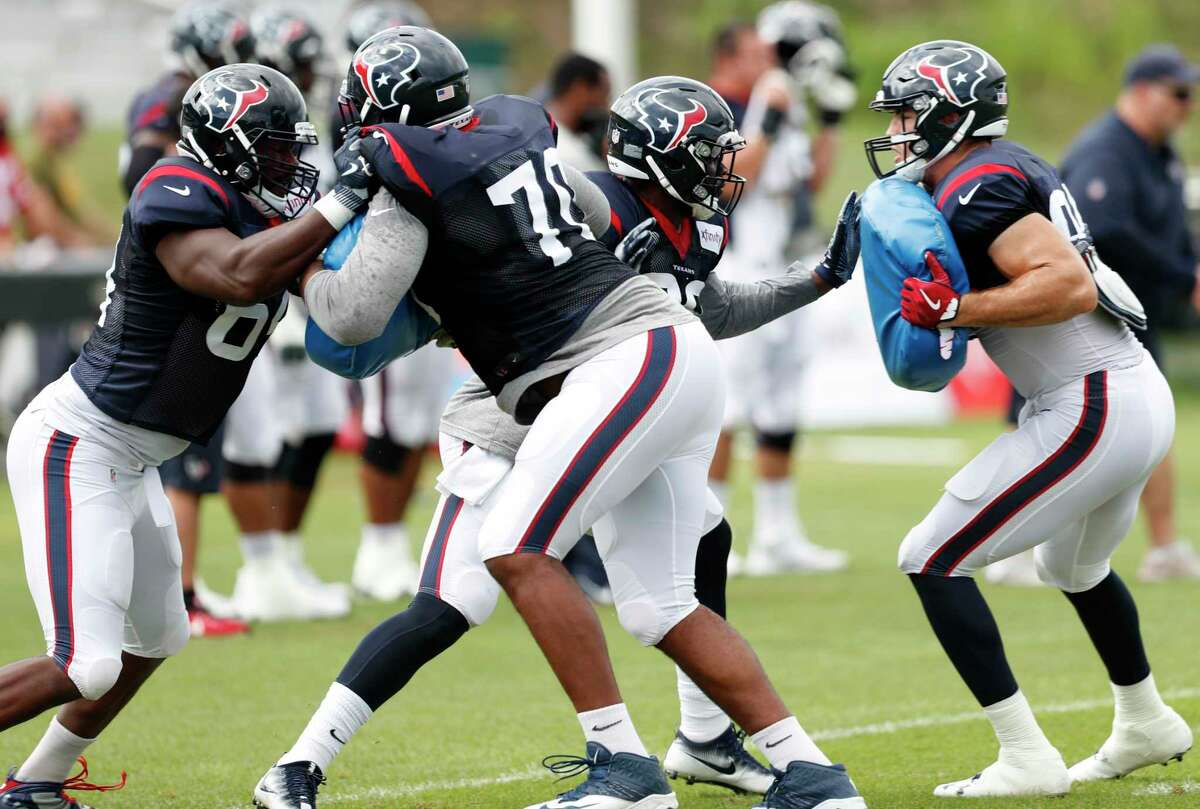 Houston Texans tackles Chris Clark (74) and Julie'n Davenport (70) runs a blocking drill during training camp at The Greenbrier on Saturday, Aug. 12, 2017, in White Sulphur Springs, W.Va.