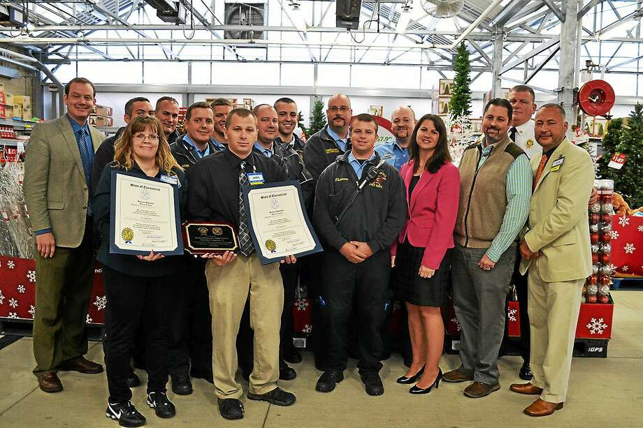 State Rep. Christie Carpino commended two Cromwell Walmart employees, Kathee Doyle and James Martel, for helping a fallen customer recently. Photo: Courtesy Connecticut House Republicans