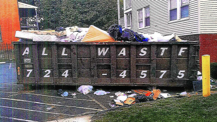 """Middletown Mayor Dan Drew took photographs of the large metal waste receptacles outside Wharfside Commons on Ferry Street in Middletown. They accompanied his harshly-worded letter to the property management company sent Oct. 28 demanding it resolve what he terms """"unacceptable living conditions"""" for residents. Photo: CONTRIBUTED PHOTO — Dan Drew"""