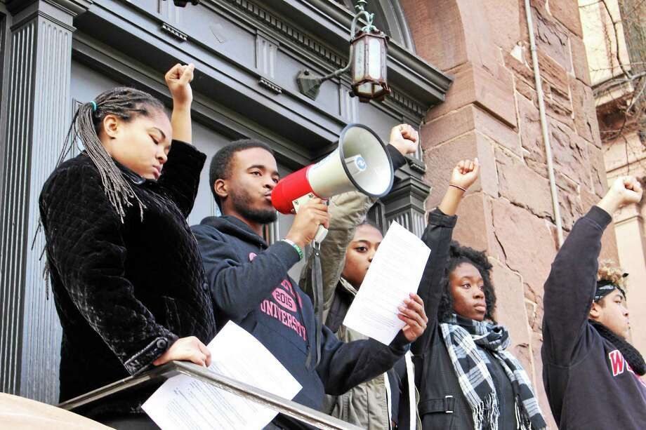 Wesleyan University students gathered in force Wednesday to protest what they call racial inequalities on campus, standing in solidarity with demonstrators at colleges across the country over the past two weeks. The protests were ignited after a similar rally at the University of Missouri. Photo: Courtesy Photos