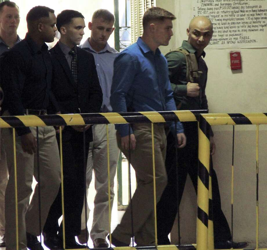 """U.S. Marine Pfc. Joseph Scott Pemberton, third left, the suspect in the Oct.11, 2014 killing of Filipino transgender Jennifer Laude at the former U.S. naval base of Subic, northwest of Manila, is escorted into the courtroom for his scheduled trial March 23, 2015 at Olongapo city, Zambales province, northwest of Manila, Philippines. Pemberton was tagged as the suspect in the killing which the protesters termed as a """"hate crime"""" against LGBT (Lesbian, Gay, Bisexual and Transgender) Filipinos. Photo: AP Photo/Jun Dumaguing  / AP"""