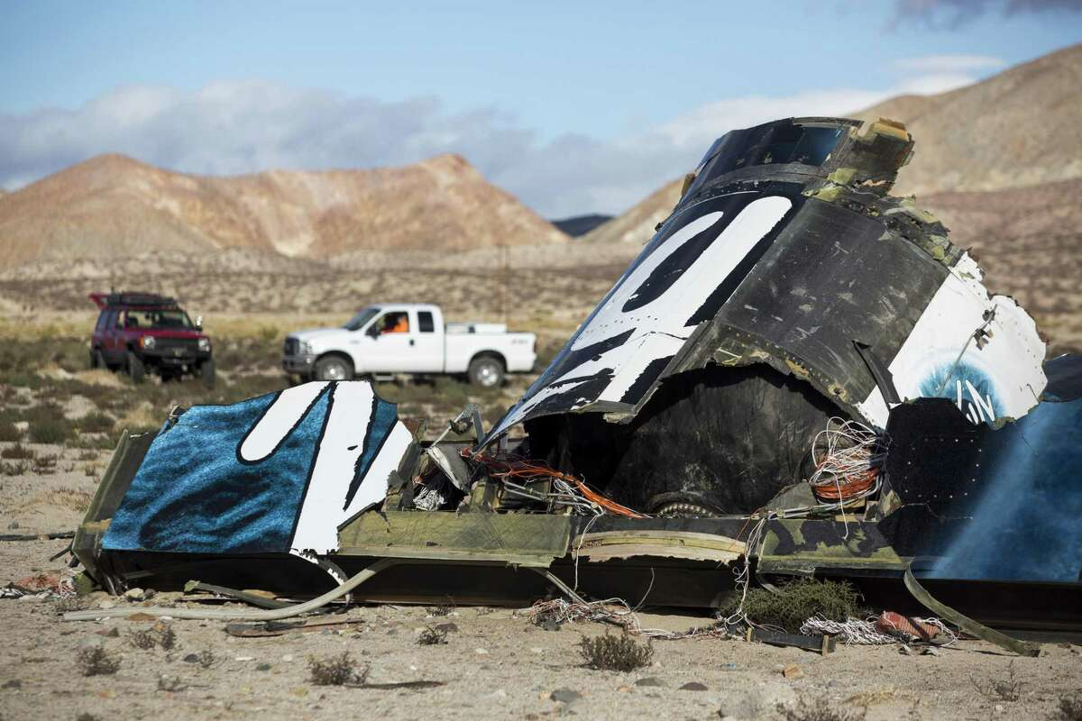 In this Nov. 1, 2014 photo, wreckage lies near the site where a Virgin Galactic space tourism rocket, SpaceShipTwo, exploded and crashed in Mojave, Calif.