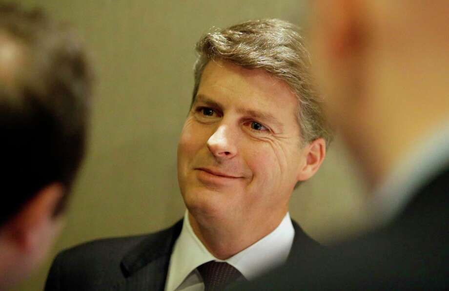 New York Yankees owner Hal Steinbrenner speaks with reporters in the lobby of the hotel hosting the baseball owners meeting on Wednesday in Dallas. Photo: LM Otero — The Associated Press  / AP