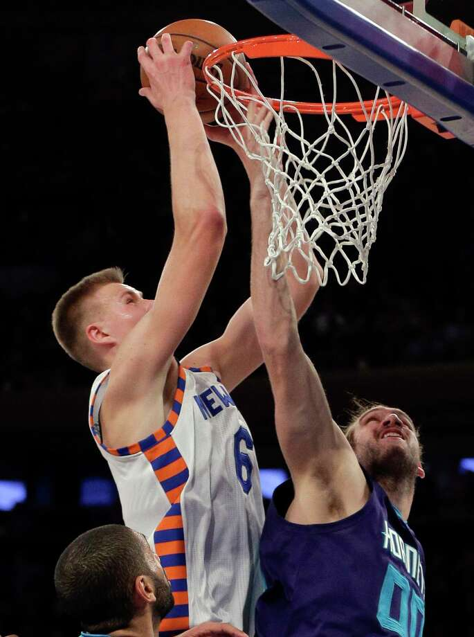 New York Knicks forward Kristaps Porzingis grabs a rebound over Charlotte Hornets forward Spencer Hawes during Tuesday's game in New York. Photo: Julie Jacobson — The Associated Press  / AP