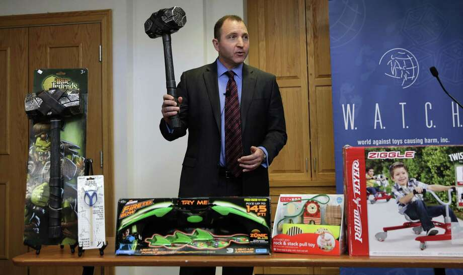 James Swartz, director of World Against Toys Causing Harm Inc., holds up toy battle hammer at Children's Franciscan Hospital in Boston. Photo: Charles Krupa — The Associated Press  / AP