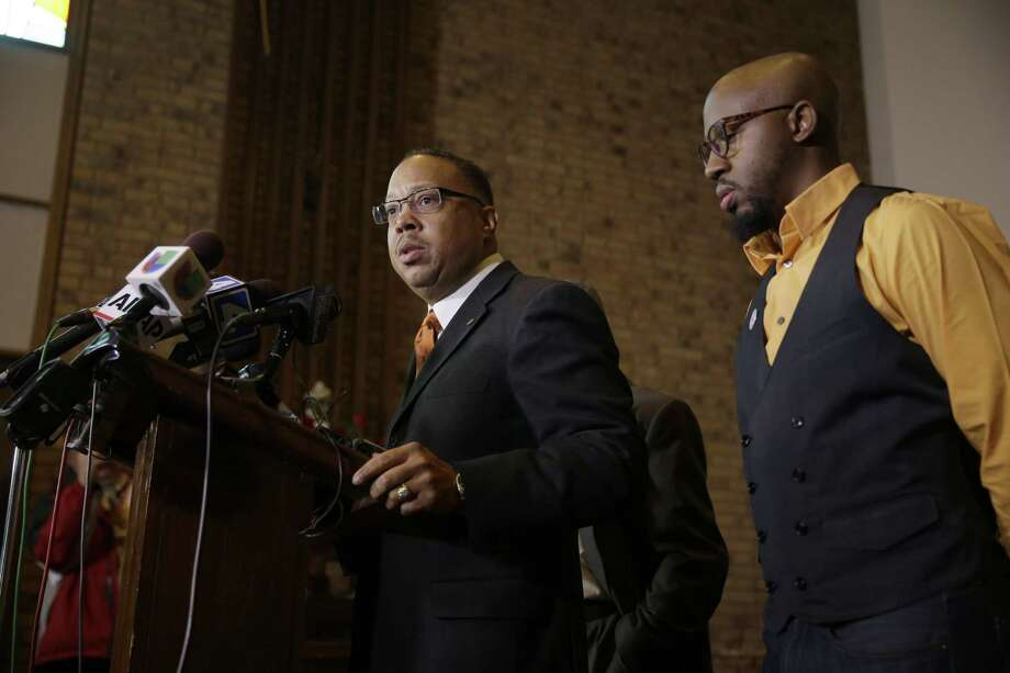 Anthony Gray, attorney for the family of Michael Brown, speaks as National Action Network Ferguson chapter president Rev. Carlton Lee, right, listens during a news conference Friday, Nov. 21, 2014, in St. Louis County, Mo. Gray and Lee spoke about preparations as citizens wait for a decision from the grand jury whether to indict Ferguson police officer Darren Wilson in the shooting of Michael Brown. Photo: (Jeff Roberson — The Associated Press) / AP