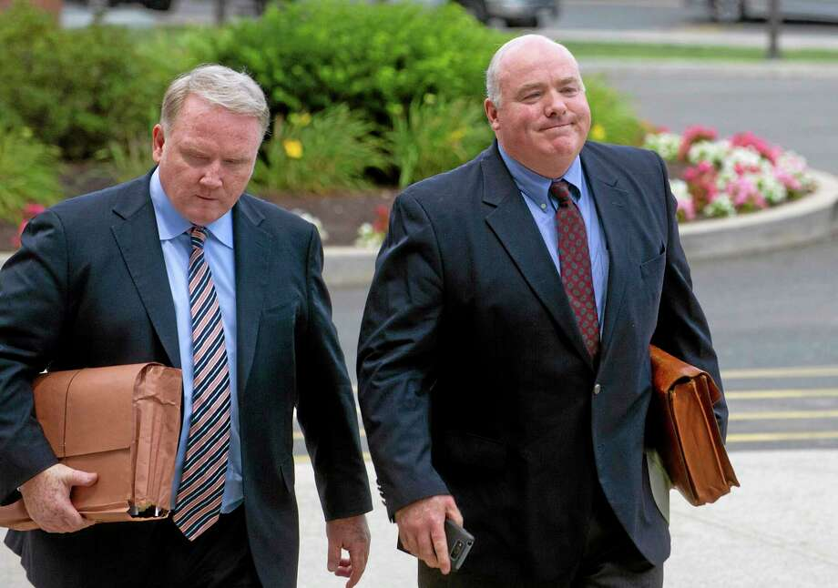 Michael Skakel, right, arrives at State Superior Court in Stamford, Conn., on Wednesday, July 30, 2014, with his attorney, Stephan Seeger, left. A Connecticut judge ordered prosecutors Wednesday to preserve all evidence as Skakel awaits a new trial in his murder case. Photo: (Lindsay Perry — Stamford Advocate) / The Advocate