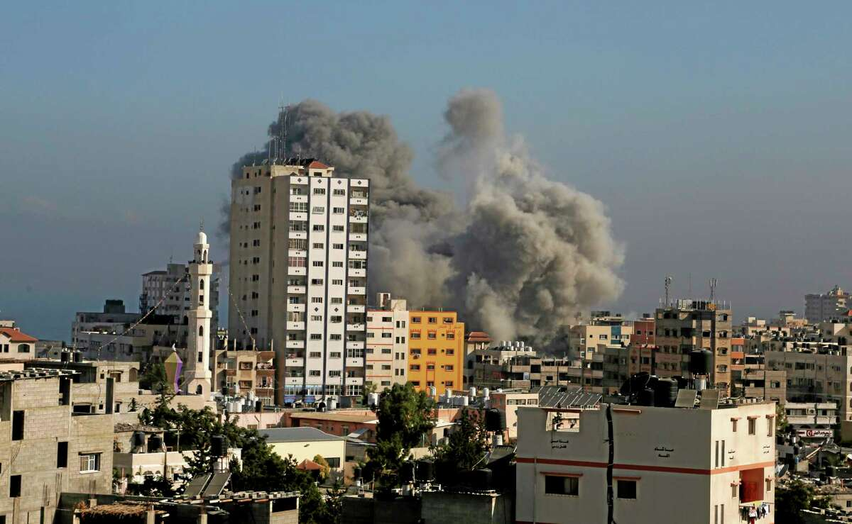 Smoke and fire from the explosion of an Israeli strike rise over Gaza City, Wednesday, July 30, 2014, amid Israel's heaviest air and artillery assault in more than three weeks of Israel-Hamas fighting. (AP Photo/Hatem Moussa)