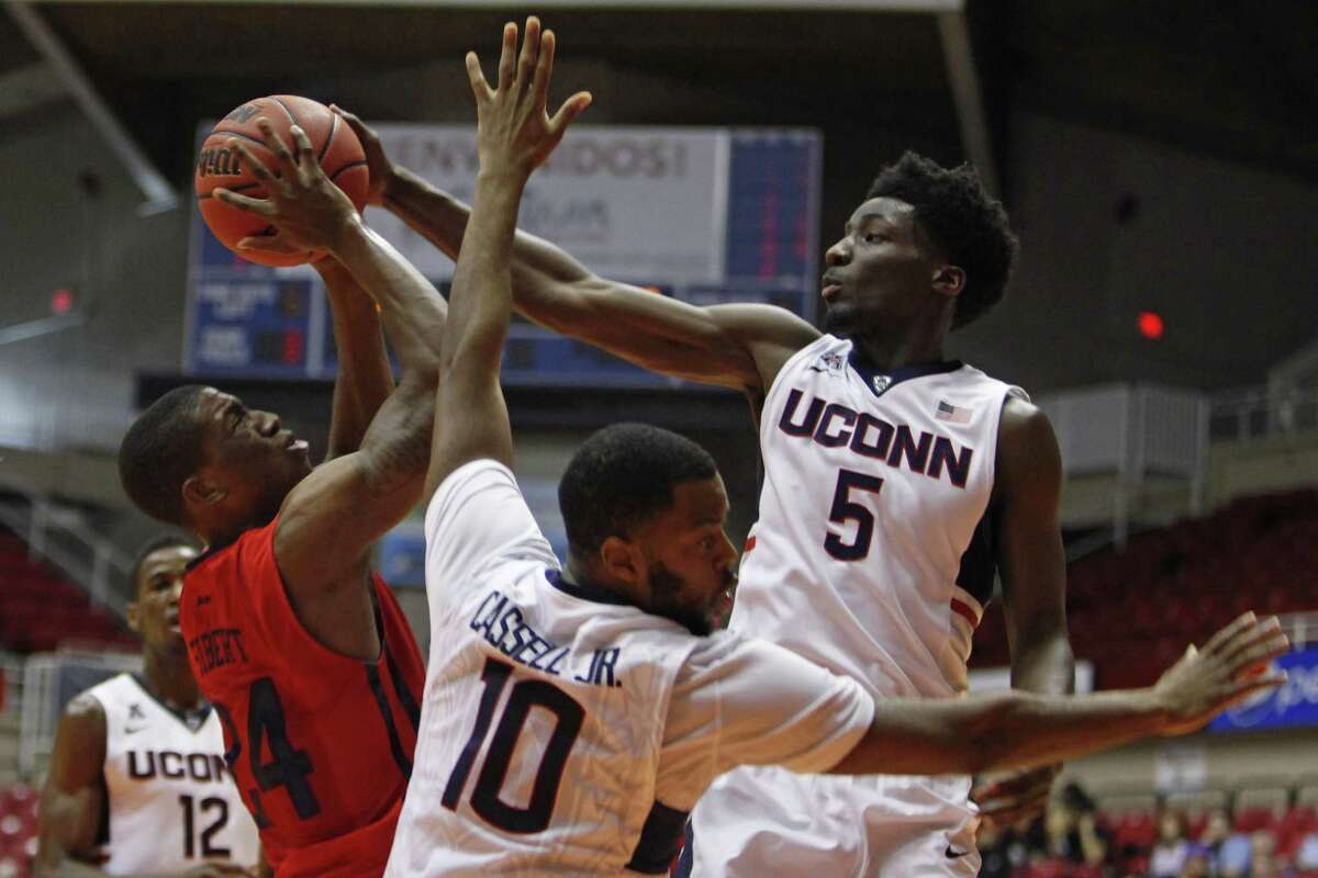 UConn's Daniel Hamilton blocks Dayton's Jordan Sibert during the 17th-ranked Huskies' 75-64 win on Friday in the Puerto Rico Tip-Off tournament in San Juan.