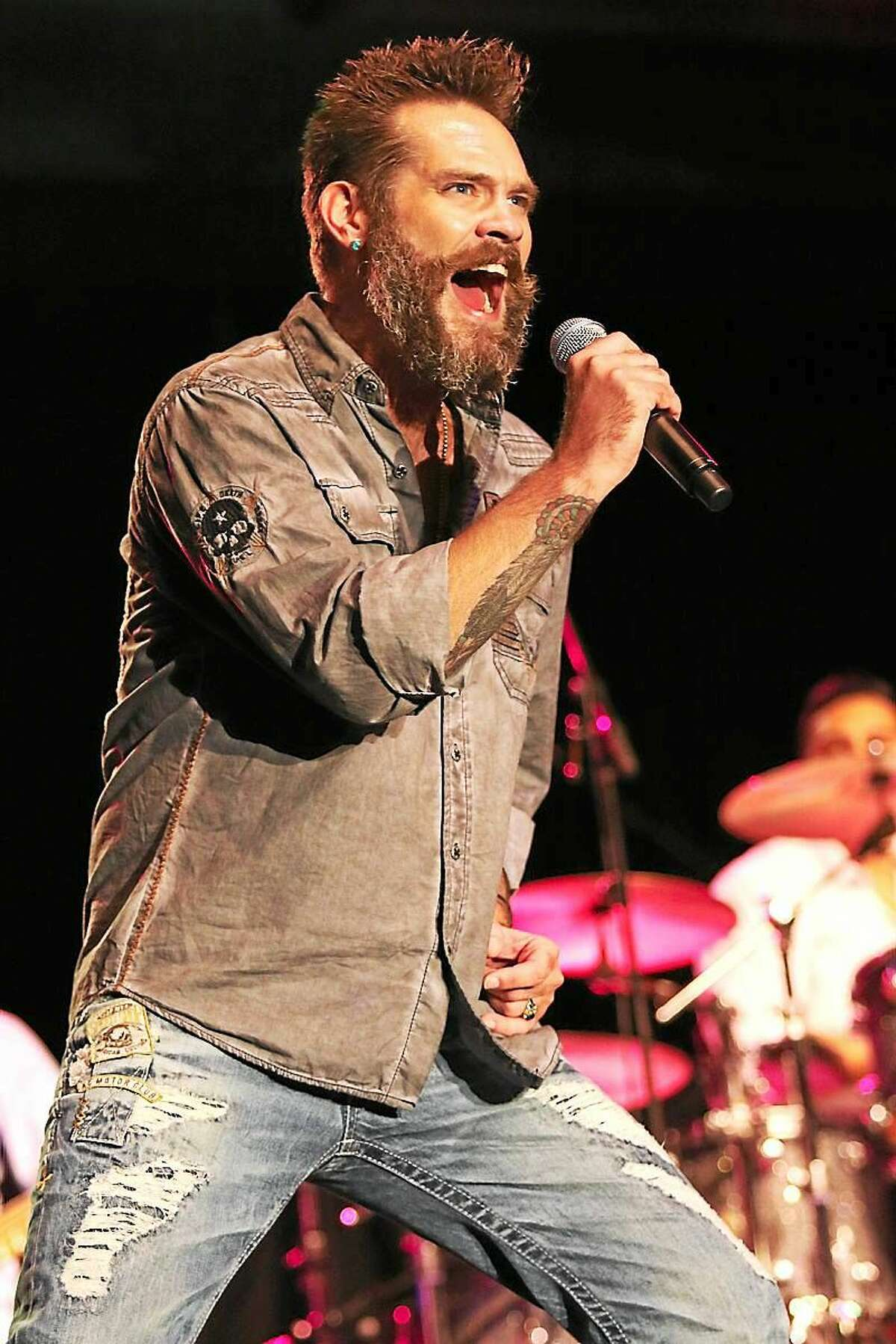 Photo by John Atashian Singer Bo Bice is shown performing on stage along with Blood, Sweat & Tears during the bandís concert at the Connecticut Convention Center in Hartford on July 24th. Also included in the double bill show was Jefferson Starship.