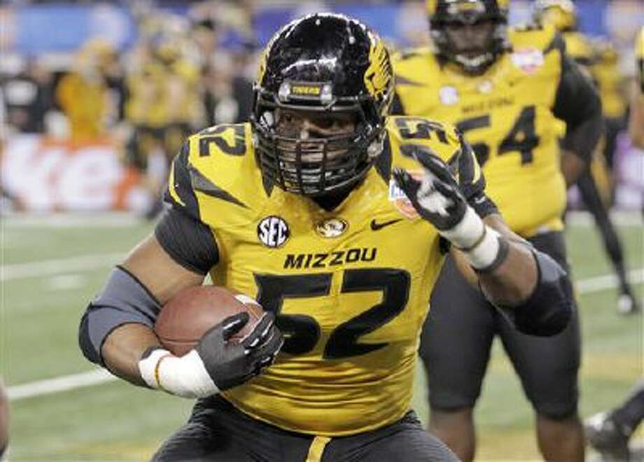 Missouri defensive lineman Michael Sam (52) warms up before the Cotton Bowl NCAA college football game against Oklahoma State, in Arlington, Texas. Missouri's All-America defensive end came out to the entire country Sunday night and could become the first openly gay player in America's most popular sport. Photo: AP / FR62992 AP