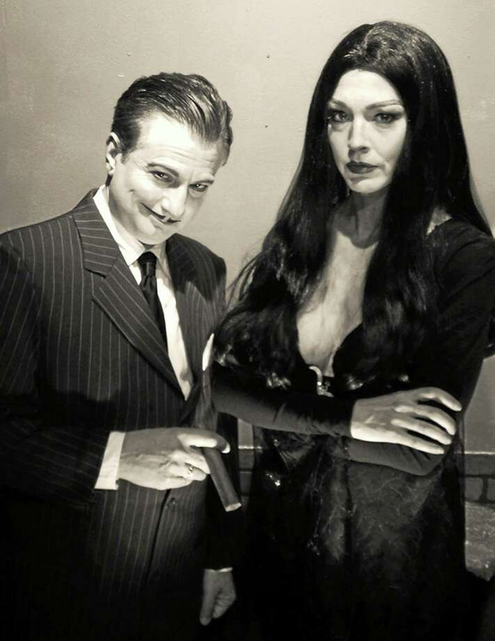 """Photo courtesy of CT Cabaret Theatre Doug LaBelle and Rachel West-Balling are Morticia and Gomez Adams in """"The Addams Family Musical"""" at the Connecticut Cabaret Theatre. Photo: Journal Register Co."""