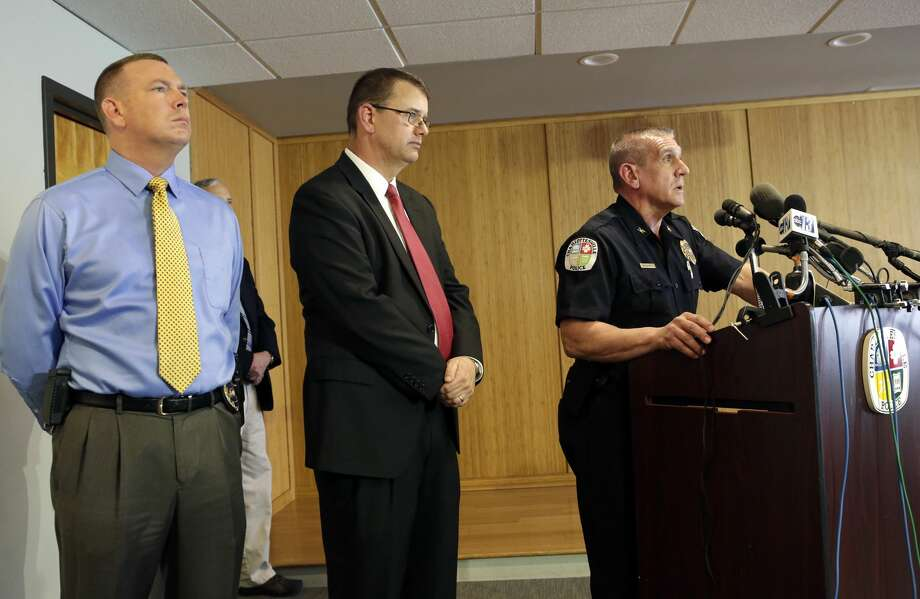 Charlottesville Police Chief Timothy Longo, right, speaks during a news conference as Detective Sgt. DJ Harris, center, and Detective Jake Via stand near Monday, March 23, 2015, in Charlottesville, Va. A five-month police investigation into an alleged gang rape at the University of Virginia that Rolling Stone magazine described in graphic detail produced no evidence of the attack and was stymied by the accuser's unwillingness to cooperate, authorities said Monday. Photo: (AP Photo/Melody Robbins) / FR187683 AP