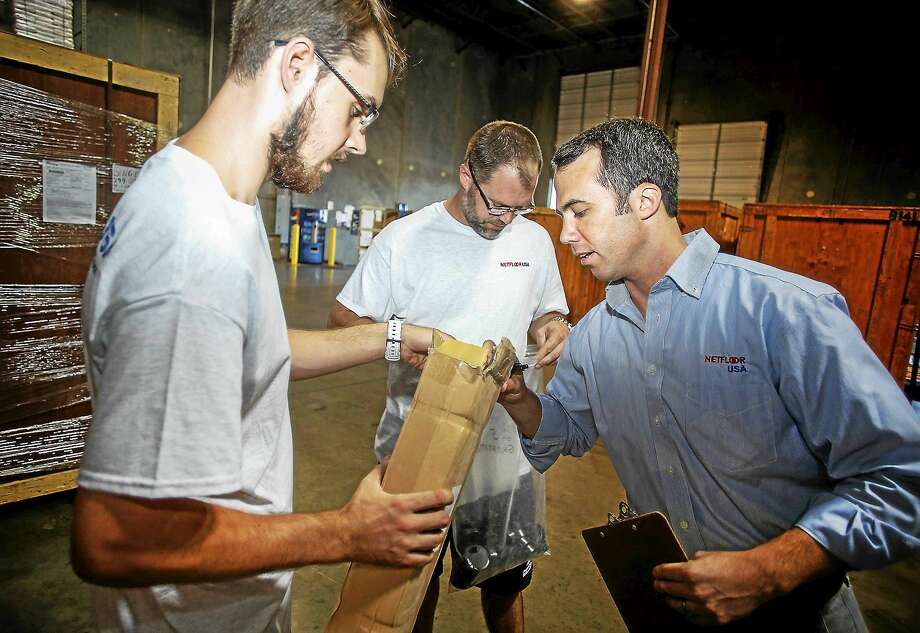 In Charlotte, N.C., Ryan Hulland, right, used to give flooring employees 6 percent or 7 percent raises, no questions asked. But that was before the 2008 financial crisis. Employees Brice Beverly, left, and James Dodd. Photo: Nell Redmond/for The Washington Post  / THE WASHINGTON POST