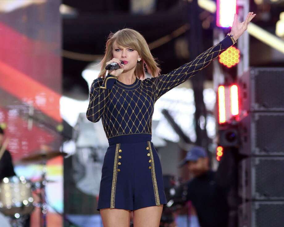 "FILE - In this Oct. 30, 2014 file photo, Taylor Swift performs on ABC's ""Good Morning America"" in Times Square in New York. Swift is getting a special, and new, award from the American Music Awards. Dick Clark productions announced Friday, Nov. 21, 2014 that Swift would receive the Dick Clark Award for Excellence at Sundayís show. Swift is receiving the honor for her record-setting sales. Titled ì1989,î her fifth album that was released last month, became the singerís third album to sell more than 1 million units in its debut week. (Photo by Greg Allen/Invision/AP) Photo: Greg Allen/Invision/AP / Invision"
