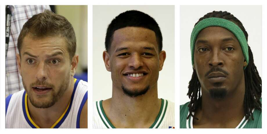 From left, David Lee, Chris Babb and Gerald Wallace Photo: AP / AP