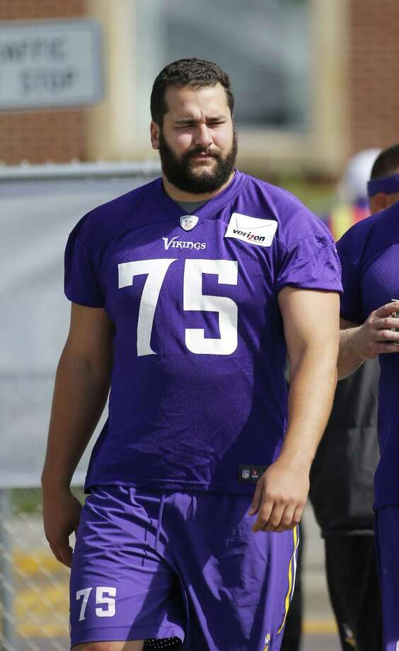 Minnesota Vikings tackle Matt Kalil walks to the practice fields at training camp on the campus of Minnesota State on Sunday in Mankato, Minn. Photo: Charles Rex Arbogast — The Associated Press  / AP
