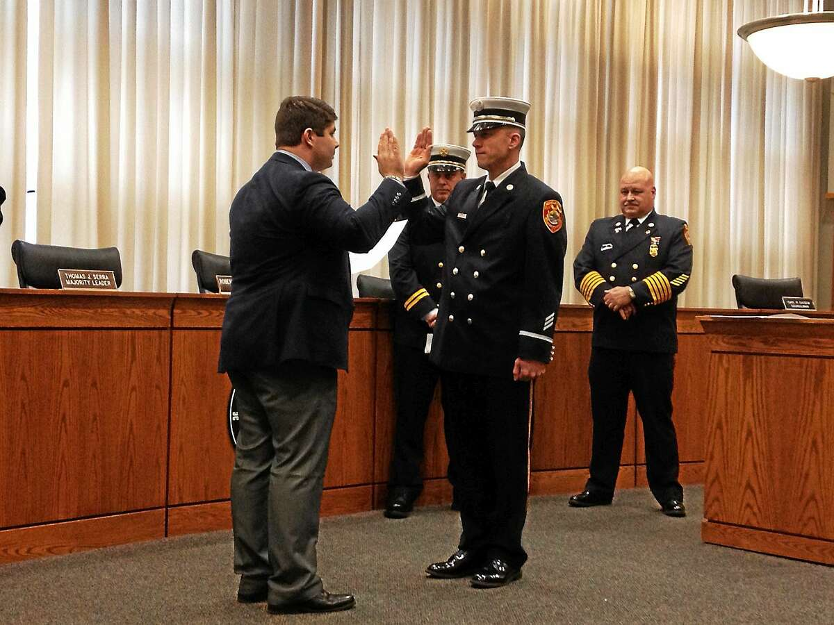 Keith Clark of the Middletown Fire Department is sworn in as lieutenant Friday afternoon.