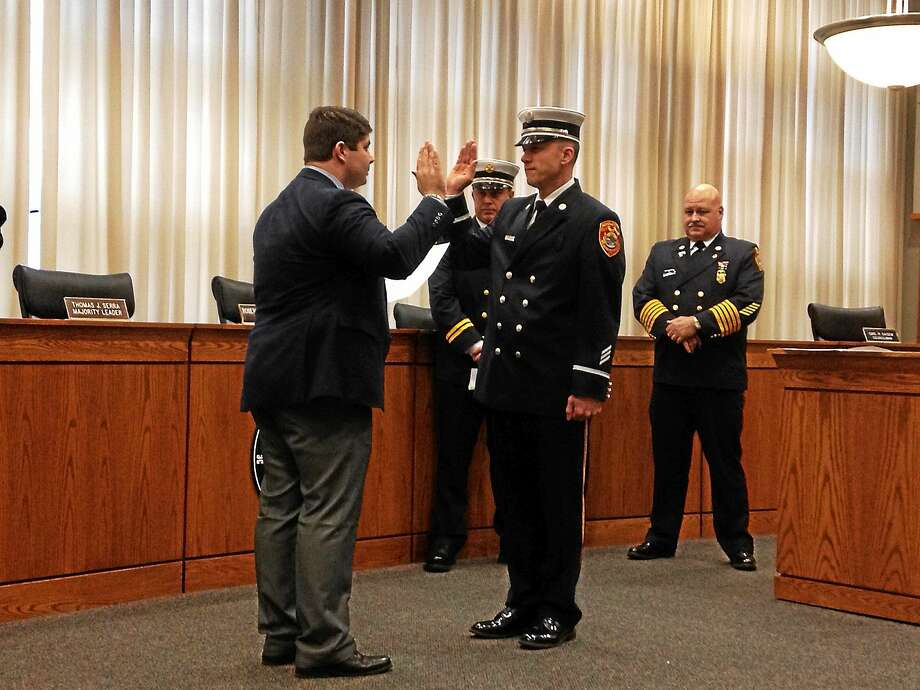 Keith Clark of the Middletown Fire Department is sworn in as lieutenant Friday afternoon. Photo: Brian Zahn — The Middletown Press