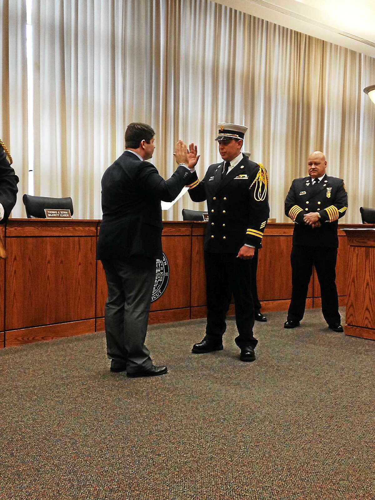 Chris Augeri of the Middletown Fire Department is sworn in as battalion chief Friday.
