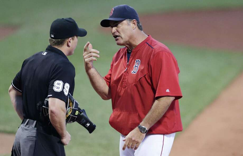Red Sox manager John Farrell argues the ejection of Mike Napoli with home plate umpire Toby Basner during the first inning on Monday. Photo: Charles Krupa — The Associated Press  / AP