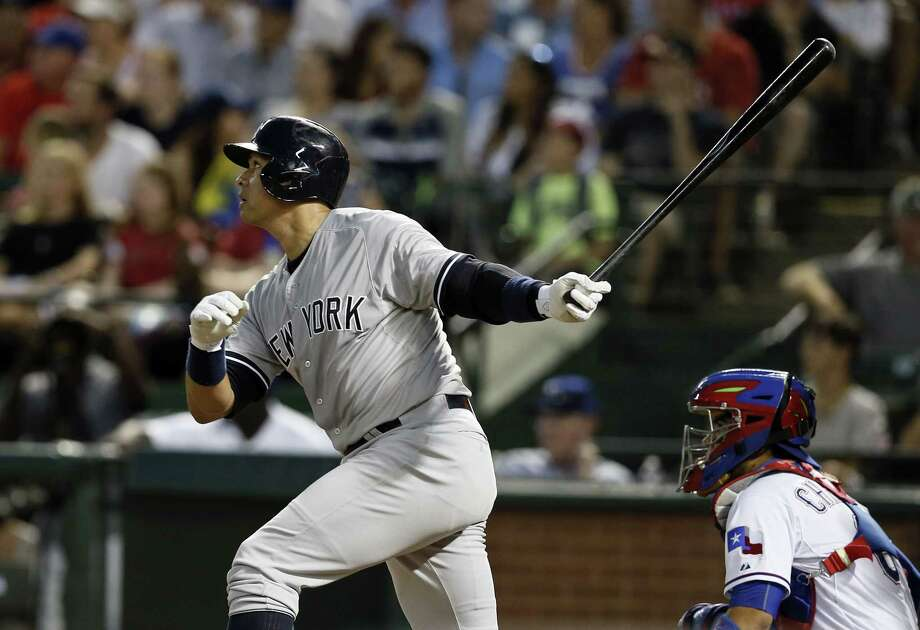 Alex Rodriguez follows through on a solo home run in the sixth inning Monday. Photo: Tony Gutierrez — The Associated Press   / AP