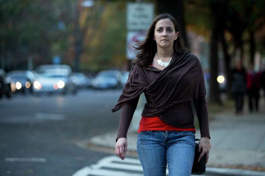 In this Nov. 11, 2014 photo, Laura Dunn, executive director of the sexual assault survivorsí organization SurvJustice, crosses the street in her neighborhood in Washington. Dunn, a victim of sexual assault, believes an affirmative consent standard could have helped her 2004 case during campus judicial proceedings, which failed to find wrongdoing, even after appeals. Photo: AP Photo/Manuel Balce Ceneta  / AP