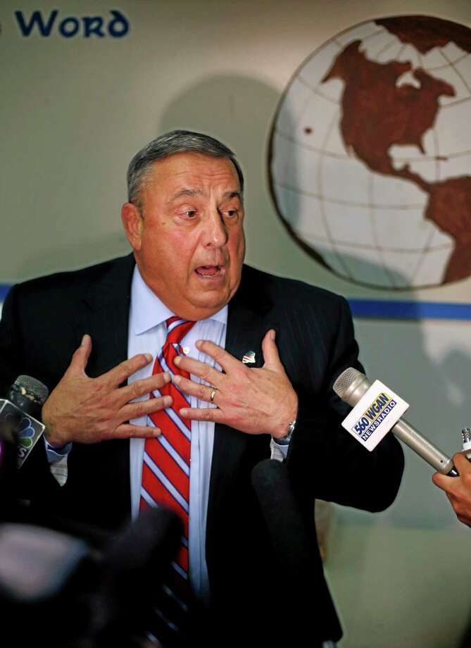 Maine Gov. Paul LePage speaks to the media at a homeless shelter Monday, July 28, 2014, in Lewiston, Maine. LePage, the governor of the state with the largest percentage of white people, placed thousands of miles from the southern border, has thrust the issue of immigration to the forefront with his criticism over the federal government's placement of eight immigrants in the state. (AP Photo/Robert F. Bukaty) Photo: AP / AP