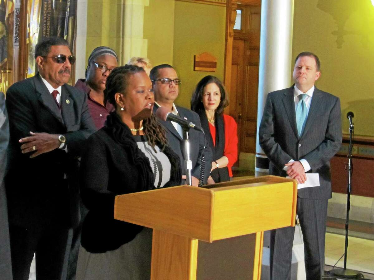 CTMirror.org photo Regina Roundtree announces a GOP outreach to black voters. At right is Senate Minority Leader John P. McKinney.