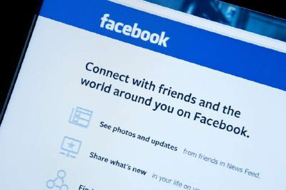 This January 30, 2014 photo taken in Washington,DC, shows the splash page for the social media internet site Facebook.