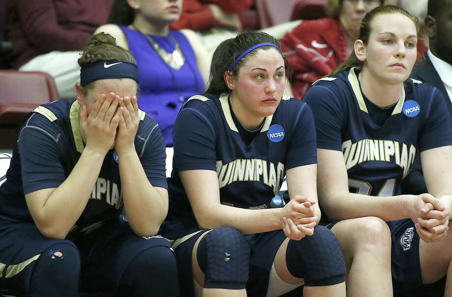 From left, Quinnipiac's Gillian Abshire, Maria Napolitano and Val Driscoll react to the Bobcats' loss to Oklahoma in the first round of the NCAA tournament on Saturday in Stanford, Calif. Photo: Tony Avelar — The Associated Press  / FR155217 AP
