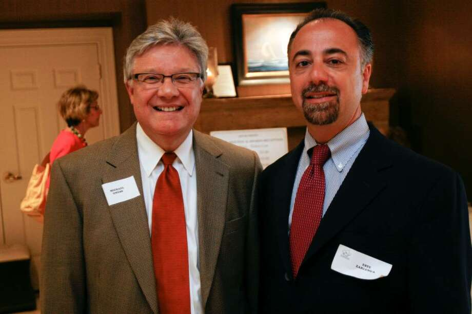 New board members of the Fairfield Chamber of Commerce, Michael Gness, left, and Este Zarlenga, right, pose for a portrait prior to a meeting at the Delamar in Southport on Wednesday, June 16, 2010. Photo: Laura Buckman / Connecticut Post