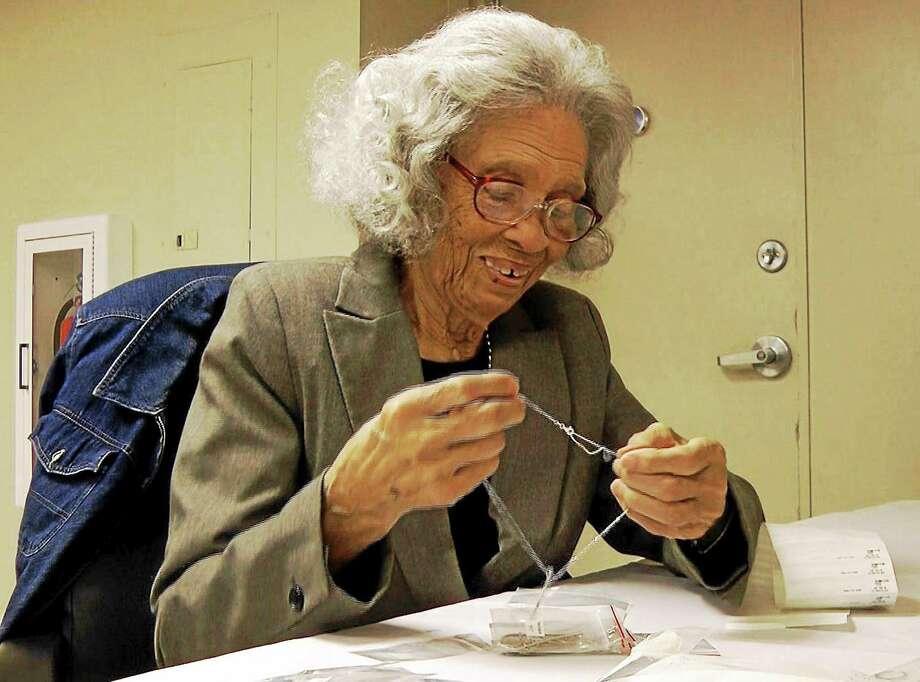 In an image from video, Frances Moore, 93, puts a tag on a necklace at Bromberg & Co. jewelry in Mountain Brook, Ala. Photo: Jay Reeves — The Associated Press  / AP
