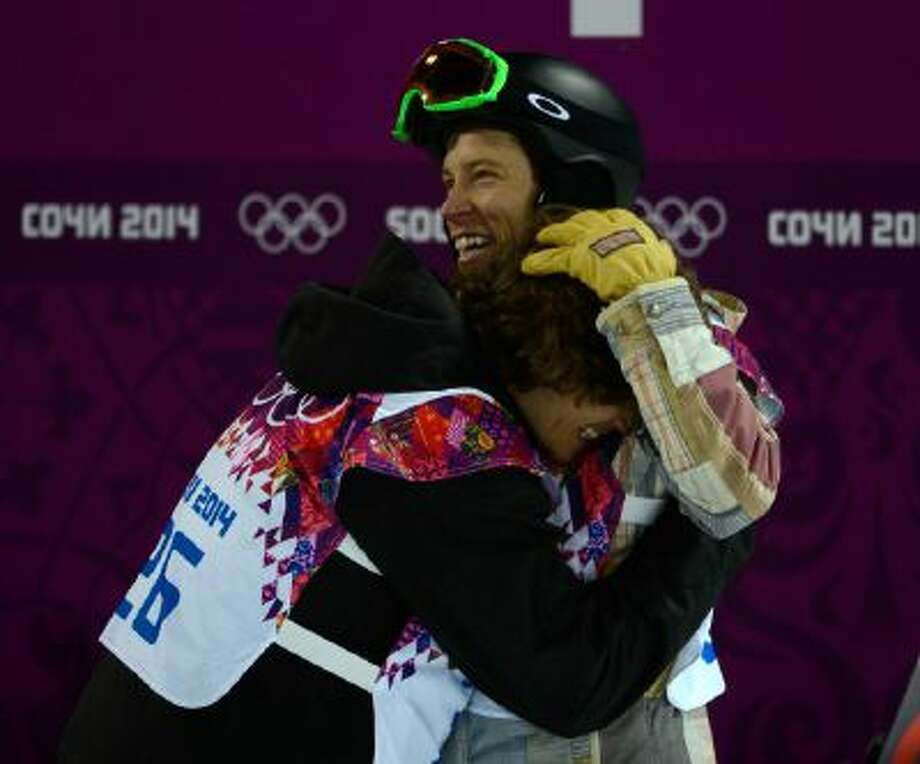 USA's Shaun White hugs Switzerland's Iouri Podladtchikov after Podladtchikov won the gold medal and White finished in fourth for the finals for men's halfpipe at the Rosa Khutor Extreme Park for the 2014 Winter Olympics in Krasnaya Polyana, Russia on Tuesday.