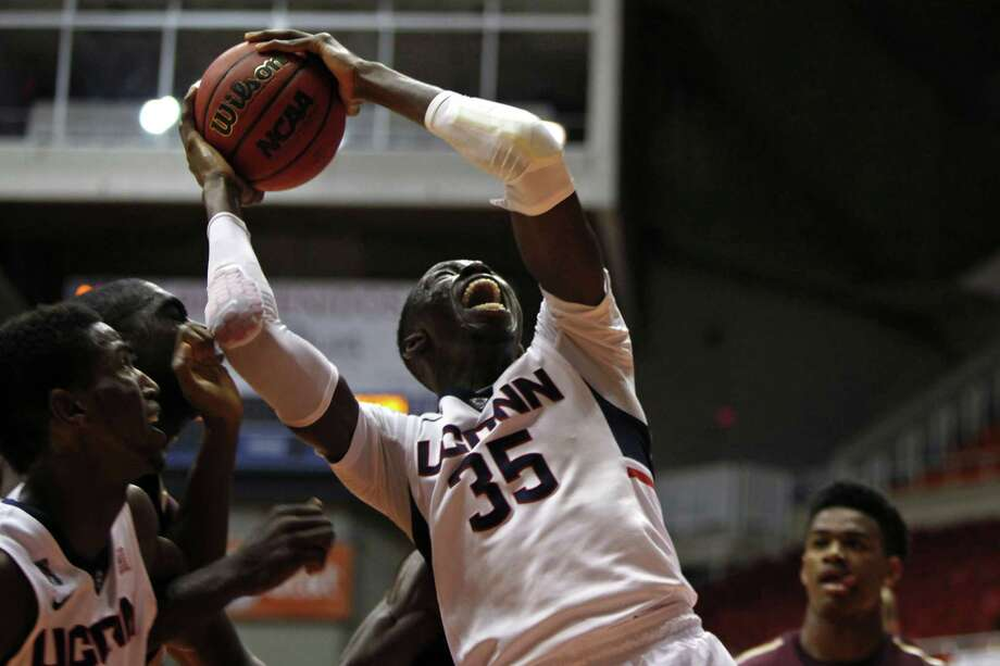 UConn center Amida Brimah grabs a rebound during the 17th-ranked Huskies' 65-57 win over College of Charleston on Thursday afternoon in San Juan, Puerto Rico. Photo: Ricardo Arduengo — The Associated Press  / AP