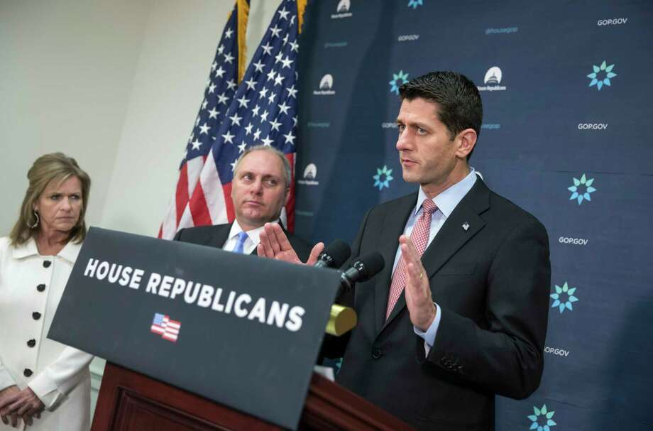 """House Speaker Paul Ryan of Wis., joined by House Majority Whip Steve Scalise of La., center, and Rep. Lynn Jenkins, R-Kansas, meets with reporters on Capitol Hill in Washington, Tuesday, Nov. 17, 2015, following a GOP strategy session. Calling this a """"moment where it's better to be safe than to be sorry,"""" Ryan said there should be a """"pause"""" in Syrian refugees coming to the U.S. in the wake of the Paris attacks, and has assembled a task force to bring legislation to a vote as soon as this week. Photo: AP Photo/J. Scott Applewhite   / AP"""