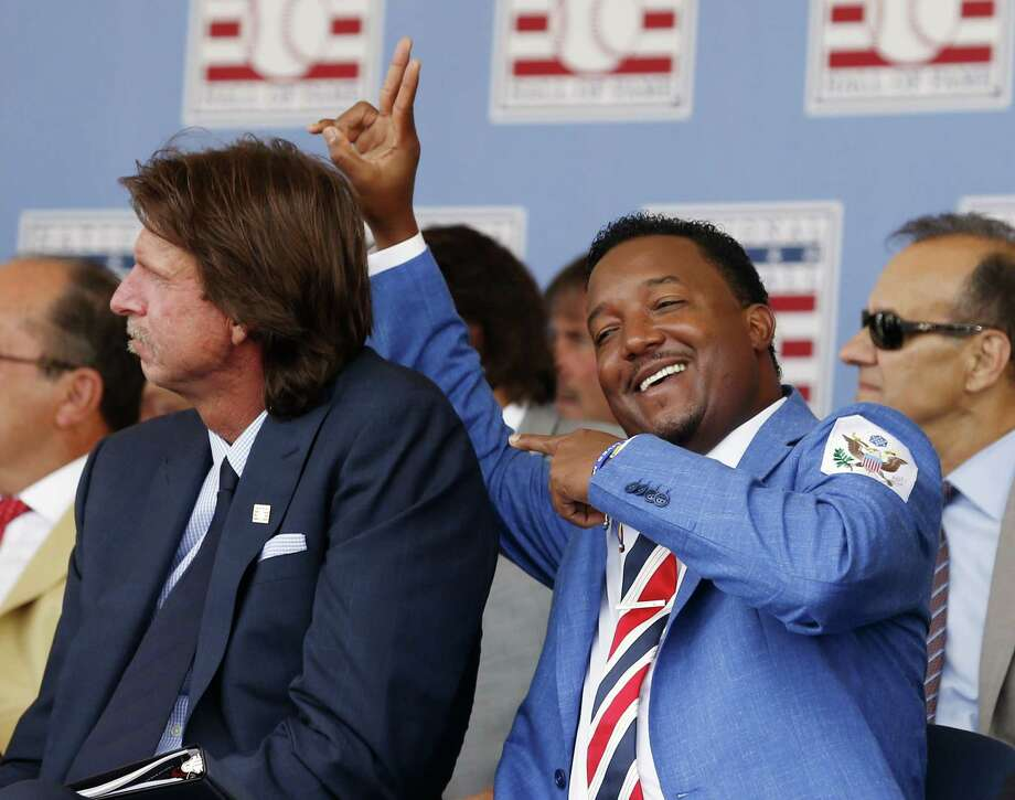 National Baseball Hall of Fame inductee Pedro Martinez, right, jokes with fellow inductee Randy Johnson during Sunday's ceremony in Cooperstown, N.Y. Photo: Mike Groll — The Associated Press  / AP