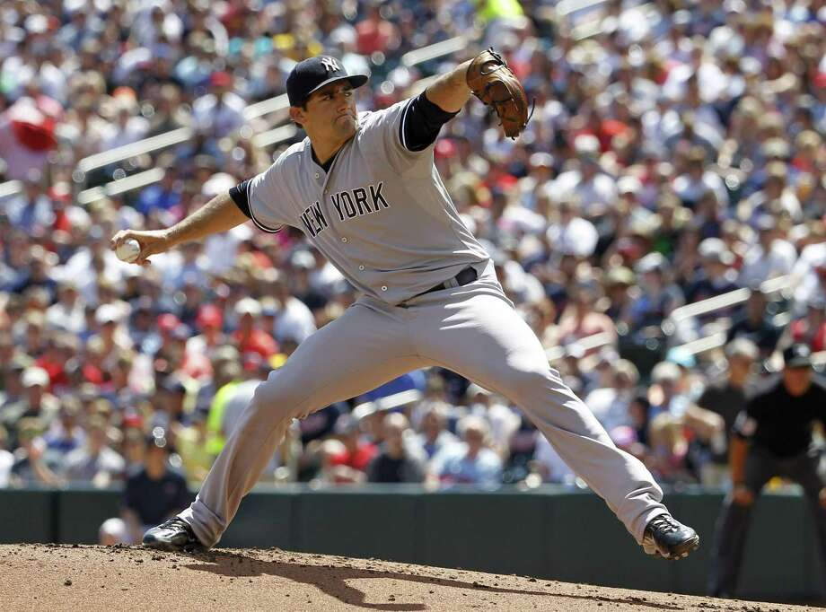 Yankees starting pitcher Nathan Eovaldi picked up his 10th win of the season on Sunday. Photo: Ann Heisenfelt — The Associated Press  / FR13069 AP