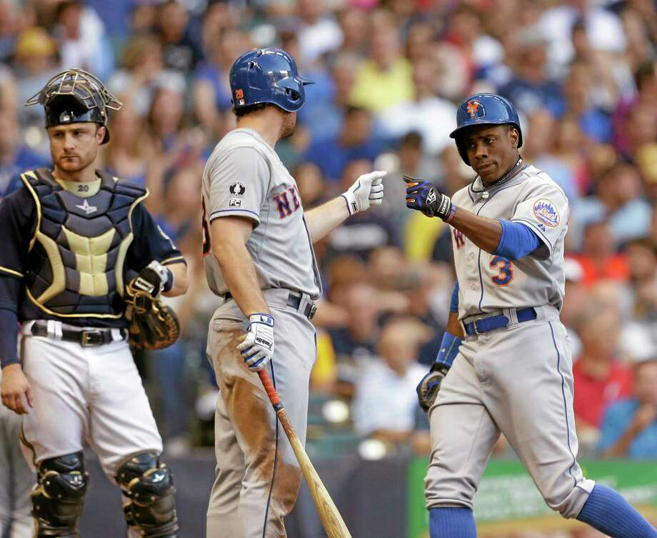 New York Mets Curtis Granderson, right, and Daniel Murphy celebrate Granderson's home run on Saturday in Milwaukee. Photo: Jeffrey Phelps — The Associated Press  / FR59249 AP