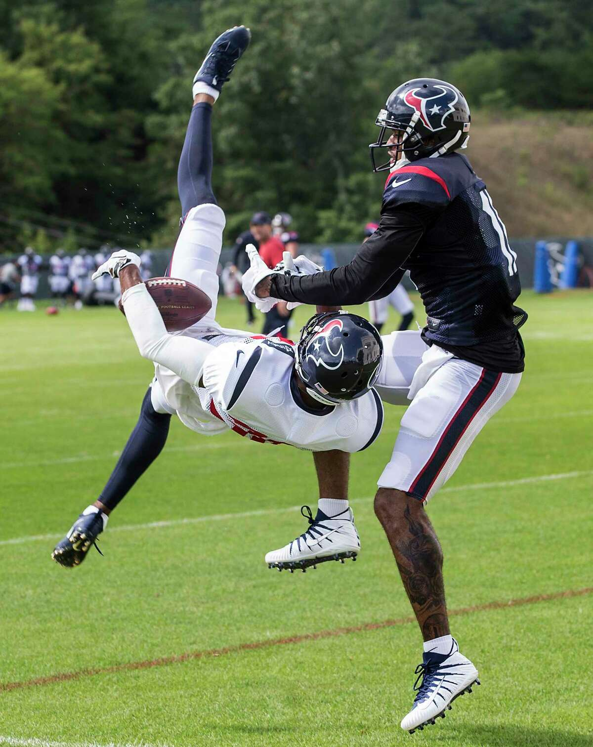 Houston Texans cornerback Kevin Johnson (30) breaks up a pass intended for wide receiver Jaelen Strong (11) during training camp at The Greenbrier on Saturday, Aug. 12, 2017, in White Sulphur Springs, W.Va.
