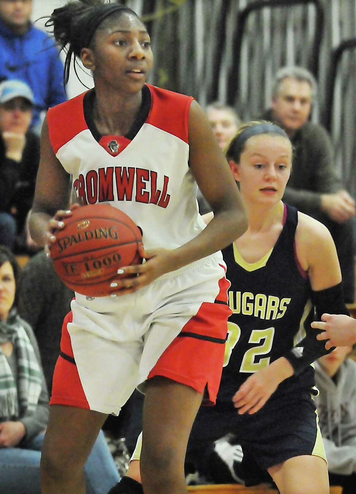 Cromwell senior forward Janelle Harrison looks to make a pass Monday night in Cromwell. Harrison put 10 points on the board for the Panthers defeating the Haddam-Killingworth Cougars 65-51.