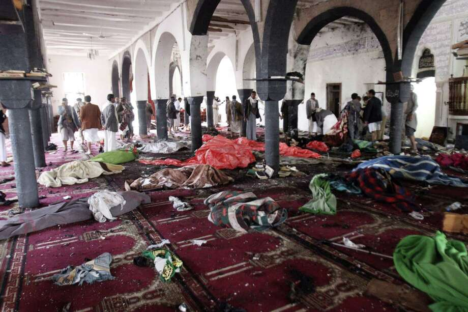 Bodies of people killed in a suicide attack during the noon prayer are covered in blankets in a mosque in Sanaa, Yemen, Friday, March 20, 2015. Triple suicide bombers hit a pair of mosques crowded with worshippers in the Yemeni capital, Sanaa, on Friday, causing heavy casualties, according to witnesses. The attackers targeted mosques frequented by Shiite rebels, who have controlled the capital since September. (AP Photo/Hani Mohammed) Photo: AP / AP