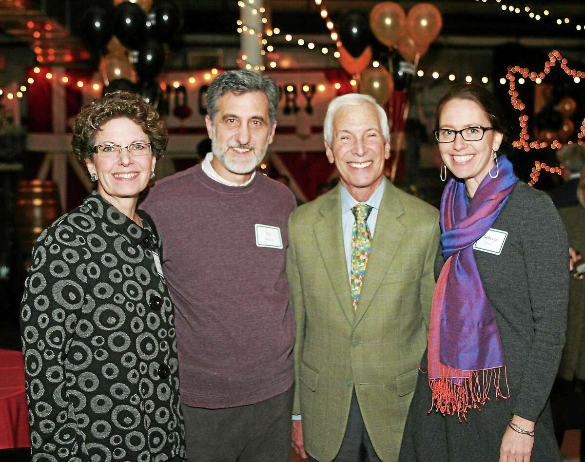 Michael Price, second from right, was joined by his family at his retirement tribute party on Nov. 15 in East Haddam.