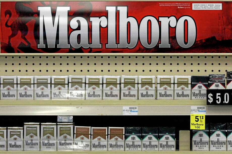 FILE - In this Wednesday, July 17, 2013 file photo, Marlboro cigarettes are on display in a CVS store in Pittsburgh. The nation's second-largest drugstore chain says it will phase out cigarettes, cigars and chewing tobacco by Oct. 1 as it continues to focus more on health care. The move will cost the Woonsocket, R.I., company about $2 billion in annual revenue. (AP Photo/Gene J. Puskar, File) Photo: AP / AP