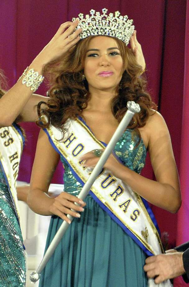In this April 26, 2014 photo, Maria Jose Alvarado is crowned the new Miss Honduras in San Pedro, Sula, Honduras. Alvarado, and her sister Sofia disappeared after attending a birthday party in Western Honduras on Thursday Nov. 13, but authorities were not notified until the weekend.  The 19-year-old beauty queen was expected to attend the Miss World pageant in Britain this December. (AP Photo) Photo: AP / AP