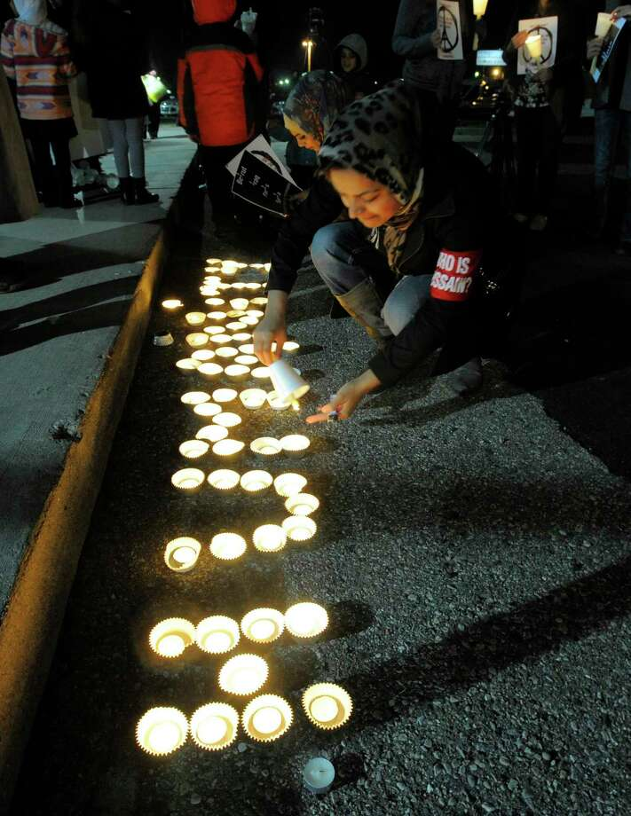 Lights spell out the word humanity during a candlelight vigil Sunday in Michigan in support of the victims of the deadly Paris attacks. Photo: FILE  / Detroit News
