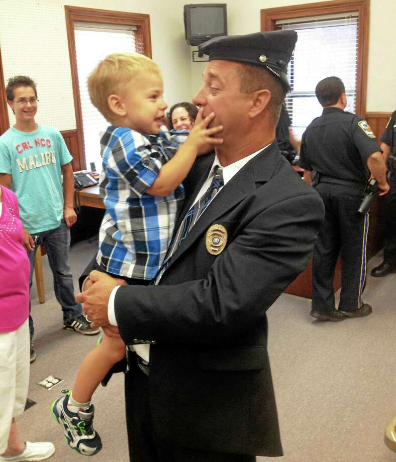 Former Middletown Police Officer Paul Liseo was sworn in Friday morning as a member of the Portland Police Department, replacing retiring Eric L. Grant. Photo: Jeff Mill — The Middletown Press