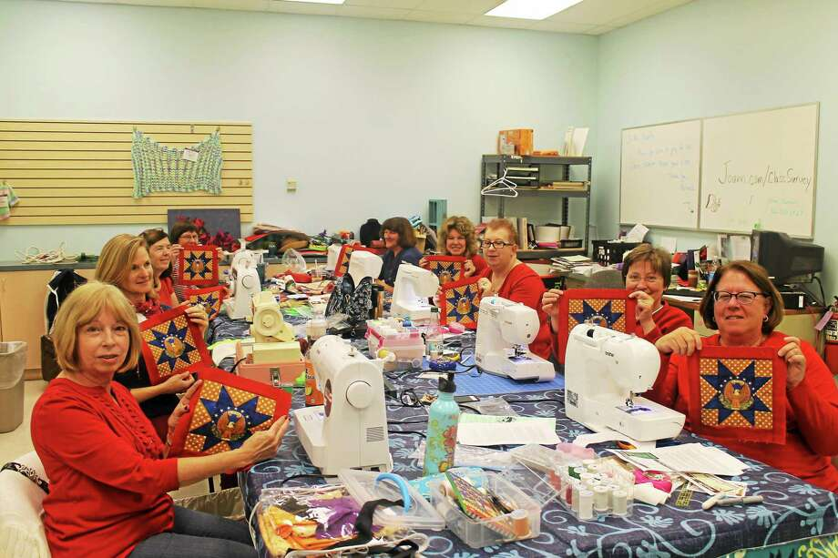 The Quilting Queens work on quilt blocks recently at Joann Fabrics in Manchester. Photo: Courtesy Of Deborah Sierpinski