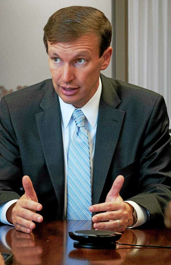 U.S. Sen. Chris Murphy talks with reporters and editors at the New Haven Register in July. Photo: File Photo — New Haven Register