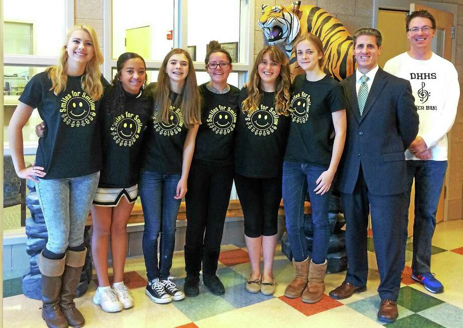 Photo courtesy of Lexi Minutillo Lexi Minutillo (fourth from right) along with members of her school club at Daniel Hand High School promoting her charity. Photo: Journal Register Co.